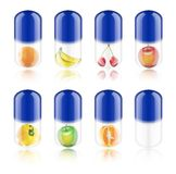 Collection blue pill with fruit. On white background Stock Images