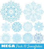 A collection of blue snowflakes. A set of blue mandala snowflakes Stock Image
