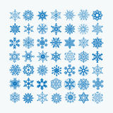 Collection of blue snowflakes on a white background Stock Images