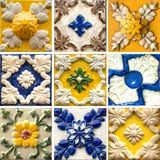 Collection of blue and yellow patterns tiles with relief. Photograph of traditional portuguese tiles in blue and yellow with relief stock images