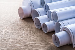 Collection of blueprint rolls on wooden oaken Royalty Free Stock Photography