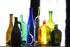 Collection bottles. Close-up collection of beautiful colored bottles of different shapes on a black and white background studio Stock Photo