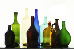 Collection bottles. Close-up collection of beautiful colored bottles of different shapes on a white background studio Stock Photos