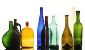 Collection bottles. Close-up collection of beautiful colored bottles of different shapes on a white background studio Royalty Free Stock Photos