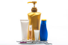 Collection of bottles of health and beauty products Scissors Royalty Free Stock Photography