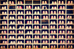 Collection of bowling shoes in their rack background. Vintage process Stock Image