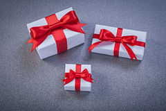 Collection of boxed presents on grey background holidays concept Royalty Free Stock Photos