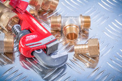 Collection of brass hardware on grooved metal background plumbin Stock Images