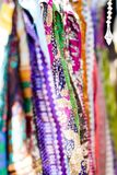 Indian Coloured Scarves. A collection of brightly coloured Indian scarves displayed at a vintage pop up market in summer stock photo