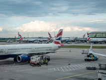 Collection of British Airways planes parked at gates at LHR London Heathrow Airport stock photography