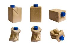 Used Brown milk carton and blue cap isolated on white background. Collection Brown milk carton is crumple isolated on white background Stock Photography