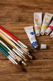 Collection of brushes and acrylic colors Stock Image