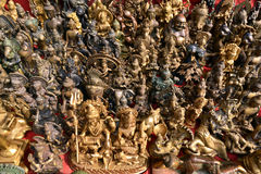 Collection of Buddhist and Hindu god statuettes Royalty Free Stock Image
