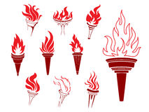 Collection of burning torches. With flames in different shaped and sized sconces suitable as design elements Royalty Free Stock Photo