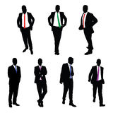 A collection of 7 Businessmen Vector Silhouettes Stock Photos