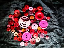Big and small colored buttons on black royalty free stock photos