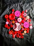 Big and small colored buttons on black royalty free stock photography