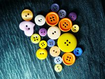 Big and small colored buttons on black royalty free stock photo