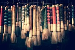 Collection of calligraphy chinese brushes at the antique market in Shanghai China royalty free stock photos