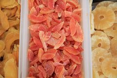 Collection of candied diced Fruits on Street Market stock images