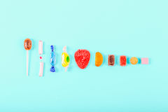 Collection of candies. In different colors and forms on light blue background Stock Images