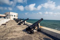 A collection of cannons in cape coast castle Ghana. Old cannons lines the cape coast castle in Ghana Africa royalty free stock images