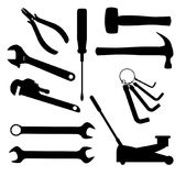 Motor Mechanics Tools. A collection of car mechanics tools in silhouette over a white backgrounds vector illustration