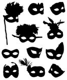 Collection of carnival masks. On a white background Stock Illustration