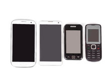 Collection of cell phones. Old design and new smart phones isolated on white Royalty Free Stock Photo