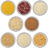 Collection of cereals and legumes. Collection of 8 cereals and legumes in bowls isolated on white background. Top view royalty free stock photo