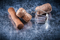 Collection of champagne corks twisted wire corkscrew on metallic Royalty Free Stock Photography