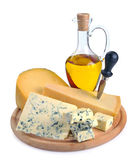 Collection of cheeses and olive oil Stock Images