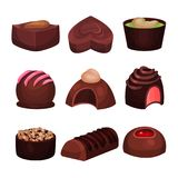Collection of chocolate candies of various shapes. Sweets with different filling. Tender souffle. Delicious truffle. Tasty confectionery products. Detailed Stock Photo