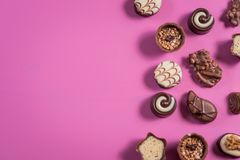 Collection of chocolate sweets on colorful background stock images