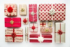 Collection of Christmas presents, overhead view. Collection of Christmas presents arranged on a white background, overhead view Stock Images