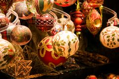 The collection of Christmas tree hanging decorations close up display window stock image
