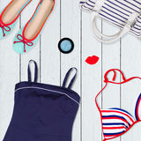 Collection of clothes on holiday on a wooden white background Stock Photos