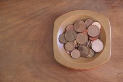 Collection coins copper pence savings in wooden bowl stock images