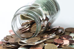 Collection of coins in a jar Royalty Free Stock Photo
