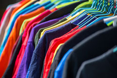 Collection of colored shirts on hangers Stock Photography