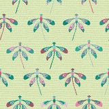 Collection of colorful dragonflies arranged in rows on a drop- textured background in a folk art style. Seamless repeat vector. Collection of colorful vector illustration