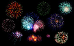 Colorful fireworks of various colors in night sky Stock Photos