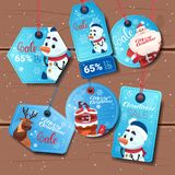 Collection Of Colorful Holiday Shopping Tags Christmas Sale Concept On Wooden Background Royalty Free Stock Photos