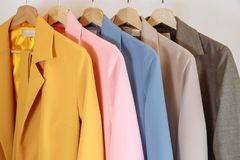 Collection of colorful jackets on hangers in shop. Stock Photography