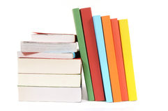 Book stack, leaning, several, isolated white background Royalty Free Stock Photo