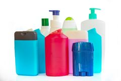 Collection of colorful plastic bottles and containers of hygiene products. On white Stock Image