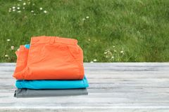 Collection of colorful short pants for kids. Stack presented on Royalty Free Stock Photos