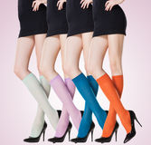 Collection of colorful short stockings on sexy woman legs. Collection of colorful short stockings on long sexy woman legs Stock Photos
