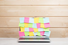 Collection of colorful sticky memos on a laptop Royalty Free Stock Photos