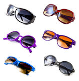 Collection of colorful sunglasses. A collection of colorful sunglasses isolated on white background Stock Photo